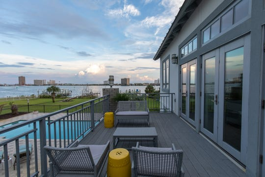 200 Sabine Drive, the balcony offers a stunning water view.