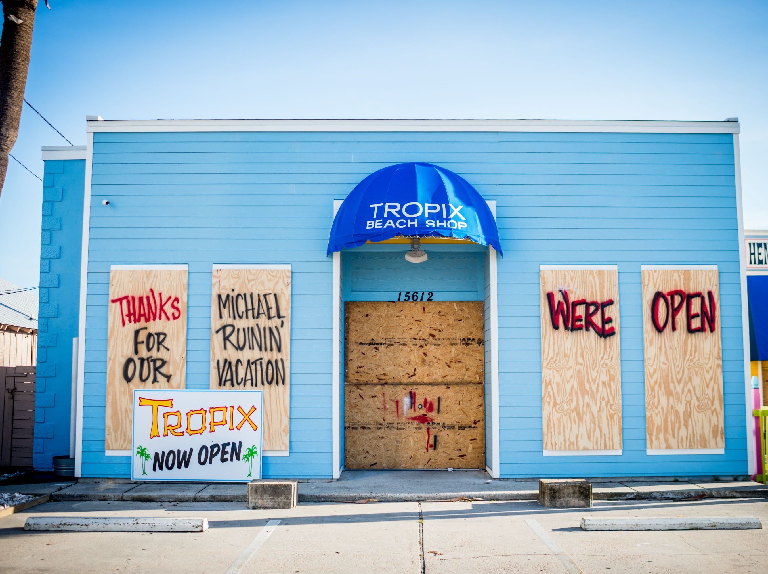 A boarded up tourist shop in Panama City Beach, Florida in the aftermath of Hurricane Michael on October 11, 2018. - Residents of the Florida Panhandle woke to scenes of devastation Thursday after Michael tore a path through the coastal region as a powerful hurricane that killed at least two people.