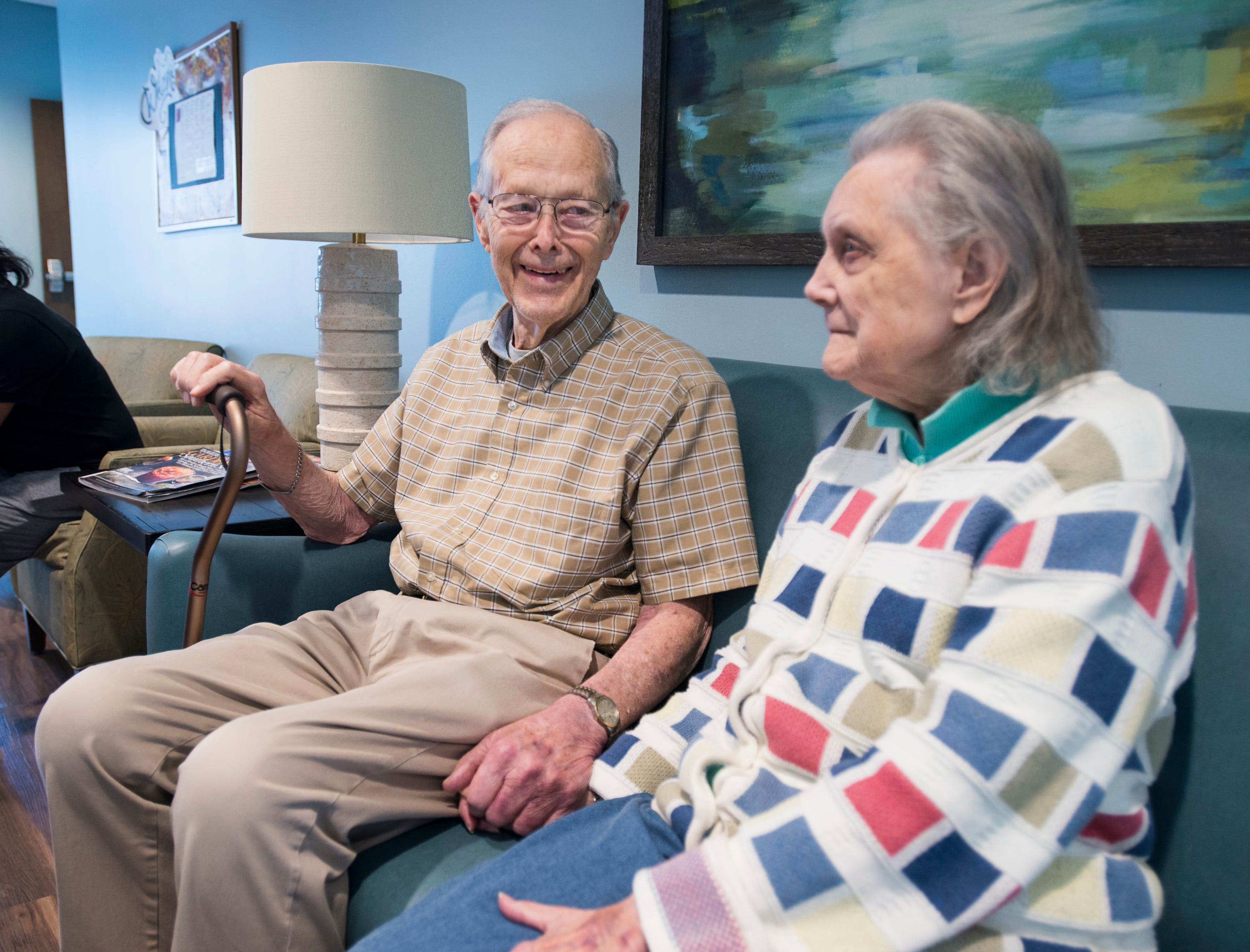 Rob Riehlman and his wife Pat, a Seagrass Village of Panama City Beach resident, talk about their temporary stay at The Arbors in Gulf Breeze on Thursday, October 11, 2018.  Seagrass residents and staff were evacuated ahead of the storm to this sister community in Gulf Breeze.  Riehlman explained that his son's house, where he lives, sustained minor damage in the storm.