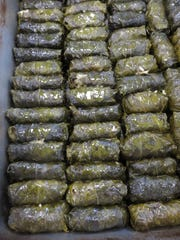 Dolmathes (stuffed grape leaves) are readied for the Greek Festival.