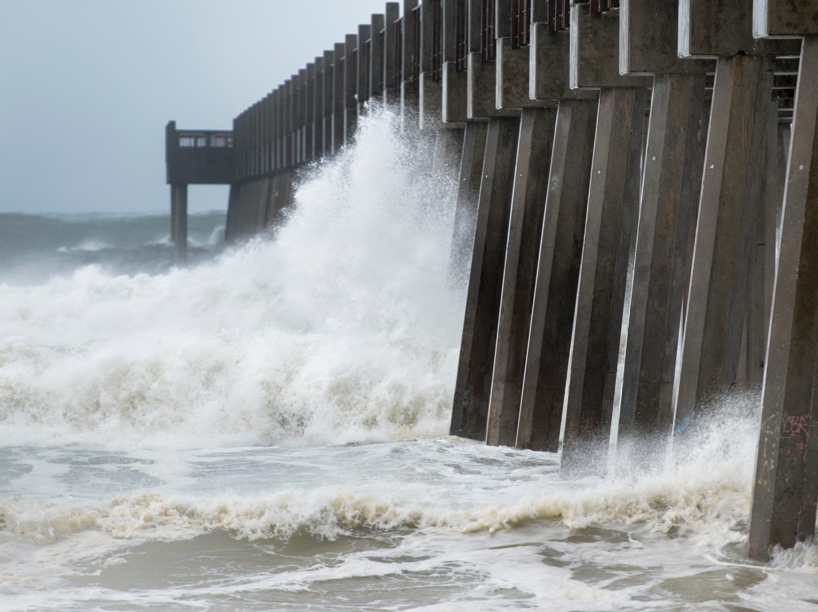 Big waves hit the pier at Casino Beach as Hurricane Michael arrives in Pensacola on Wednesday, October 10, 2018.