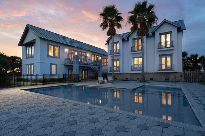 200 Sabine Drive, the home is breathtaking at sunset.