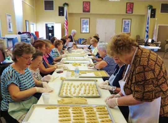 Parishioners twist dough to form koulouria butter cookies.