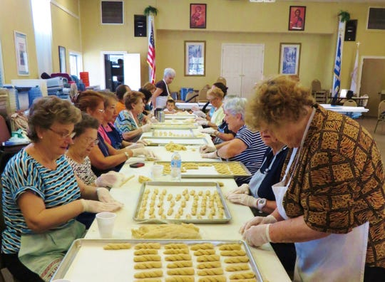 Parishioners twist dough to form koulouria butter cookies.