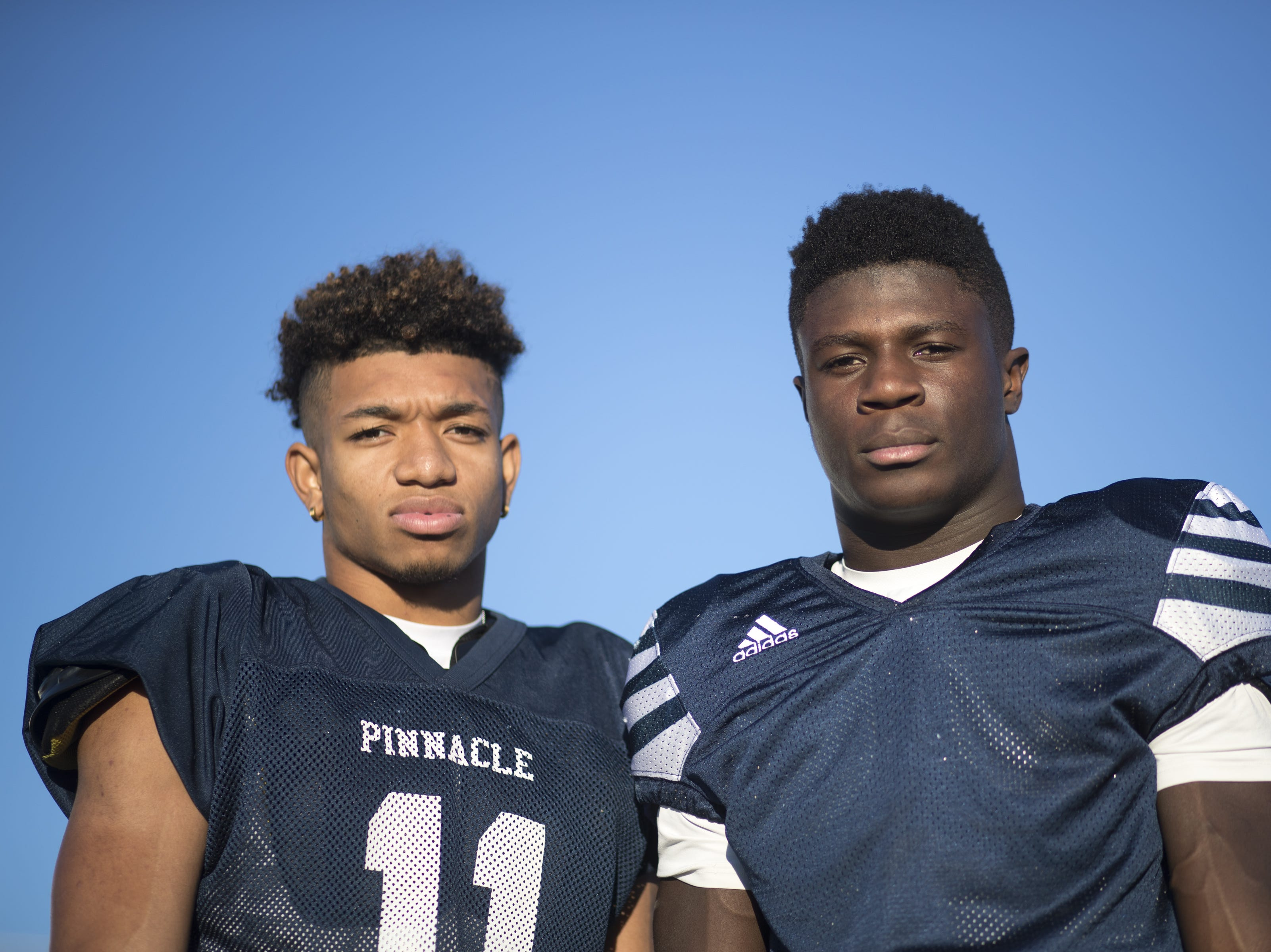 A portrait of Kaleb Covington (left) and Amelec Juntunen during football practice, October 9, 2018, at Pinnacle High School, Phoenix.