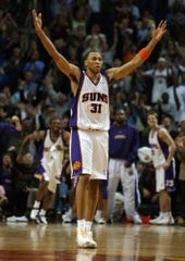 Shawn Marion of the Suns celebrates after hitting a three-pointer to help force overtime in the Suns' 115-111 victory against the Chicago Bulls, Monday, Feb. 3, 2003, at America West Arena in Phoenix.