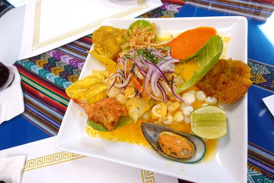 Orgia de Marisco with mixed seafood, fresh lime juice, pisco, sweet potato and tostones at Los Andes Peruvian Cuisine in Phoenix.