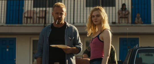 "Roy (Ben Foster) and Raquel (Elle Fanning) are on the run in ""Galveston."""
