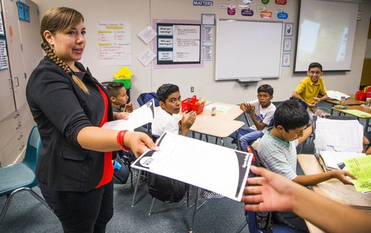 Rebecca Garelli hands out information during her 6th grade science class at Sevilla West Elementary School in Phoenix, at 8:44 am, Monday, September 17, 2018. Garelli has been one of the leaders of the #RedforEd movement, demanding increased funding for education in Arizona.