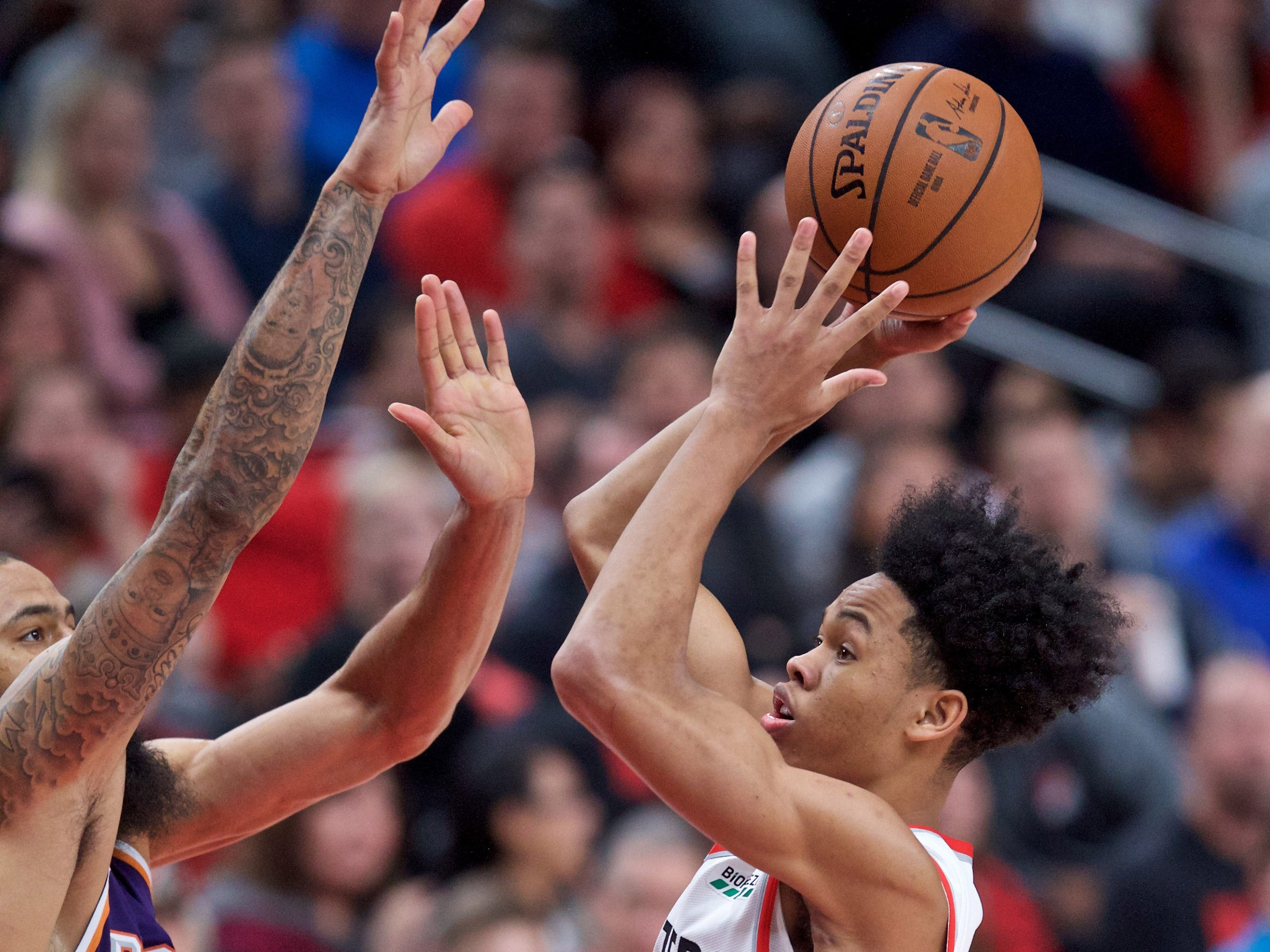 Oct 10, 2018; Portland, OR, USA; Portland Trail Blazers guard Anfernee Simons (24) shoots over Phoenix Suns guard Troy Daniels (30) during the third quarter at the Moda Center.