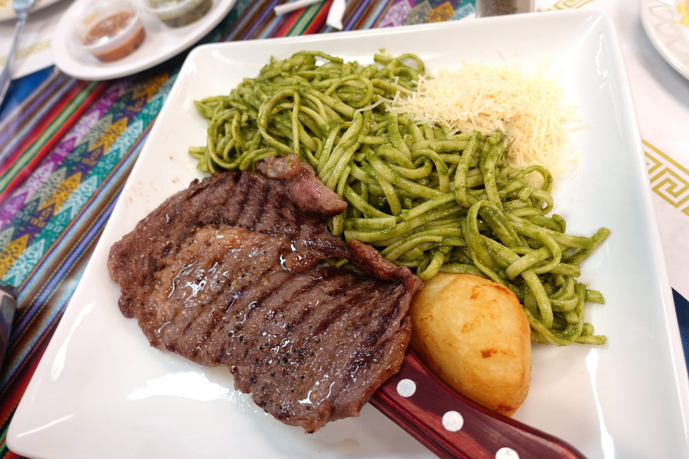 Tallarines Verdes con Bisteck, linguine with pesto and grilled beef loin, at Los Andes Peruvian Cuisine in Phoenix.