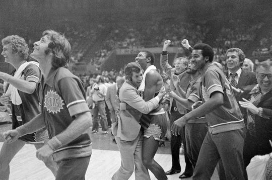 Suns coach John MacLeod hugs Curtis Perry as his Suns defeated the Golden State Warriors to win the NBA Western Conference title in Oakland on May 16, 1976.
