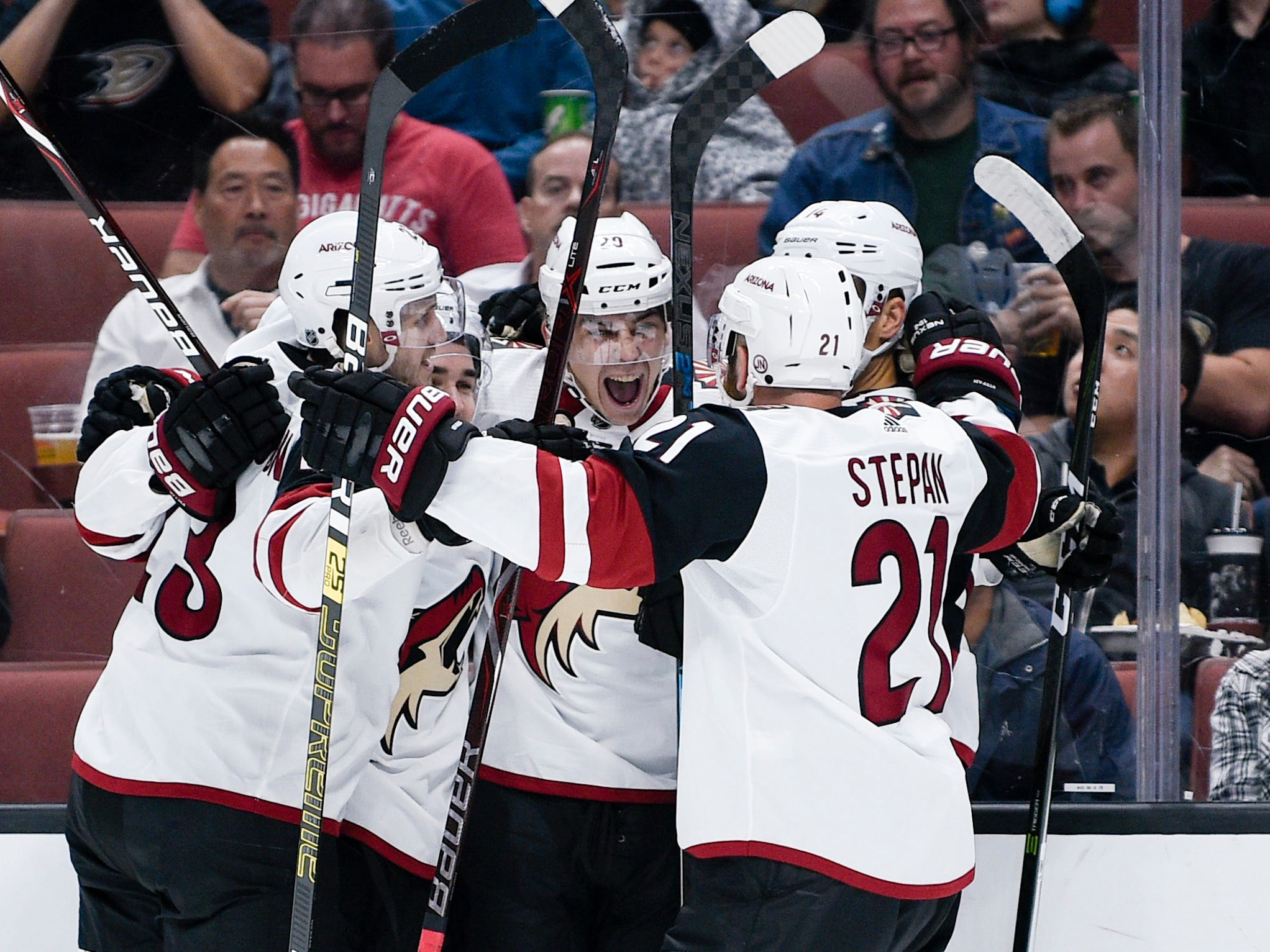Oct 10, 2018; Anaheim, CA, USA; Arizona Coyotes center Dylan Strome (center) celebrates his goal with his team during the first period against the Anaheim Ducks at Honda Center.