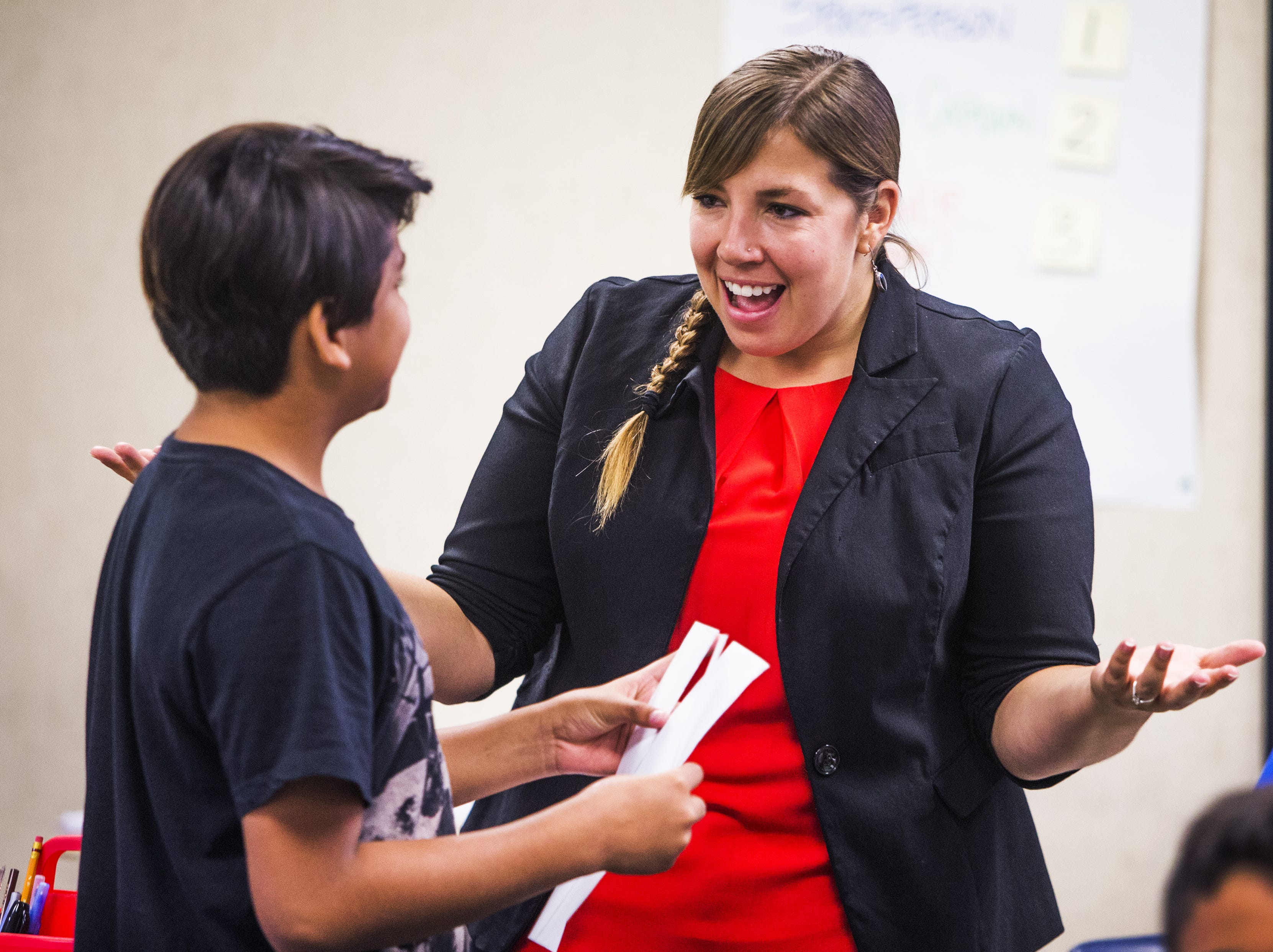 Rebecca Garelli speaks with a student in her 6th grade science class at Sevilla West Elementary School in Phoenix, Monday morning, September 17, 2018. Garelli has been one of the leaders of the #RedforEd movement, demanding increased funding for education in Arizona.