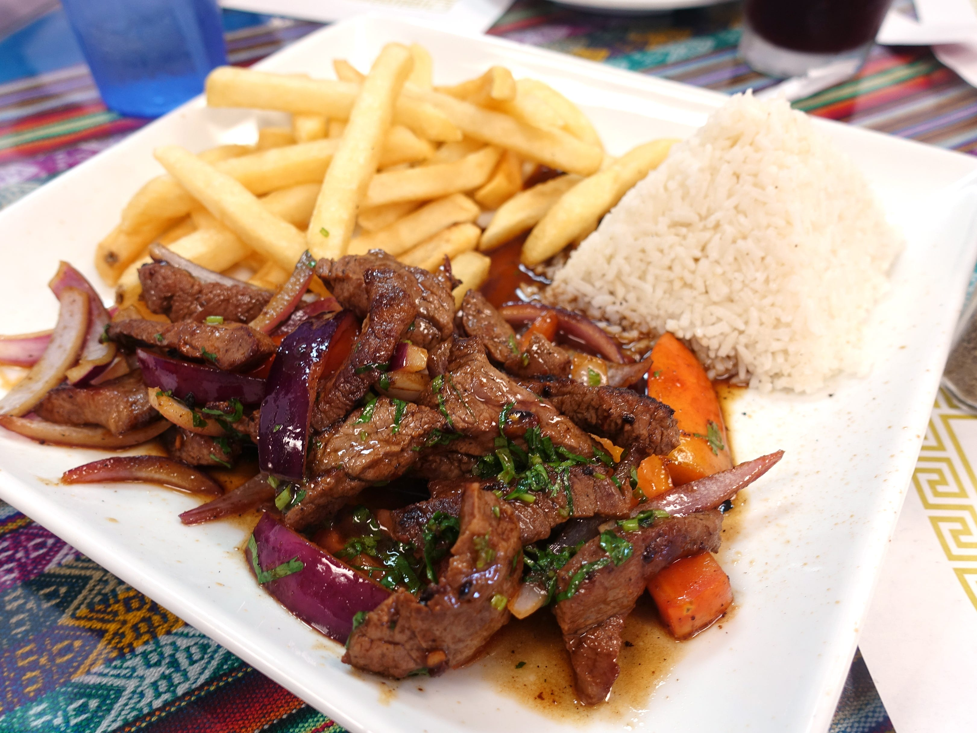 Lomo saltado with beef loin, onions, tomatoes, cilantro mignonette and French fries at Los Andes Peruvian Cuisine in Phoenix.