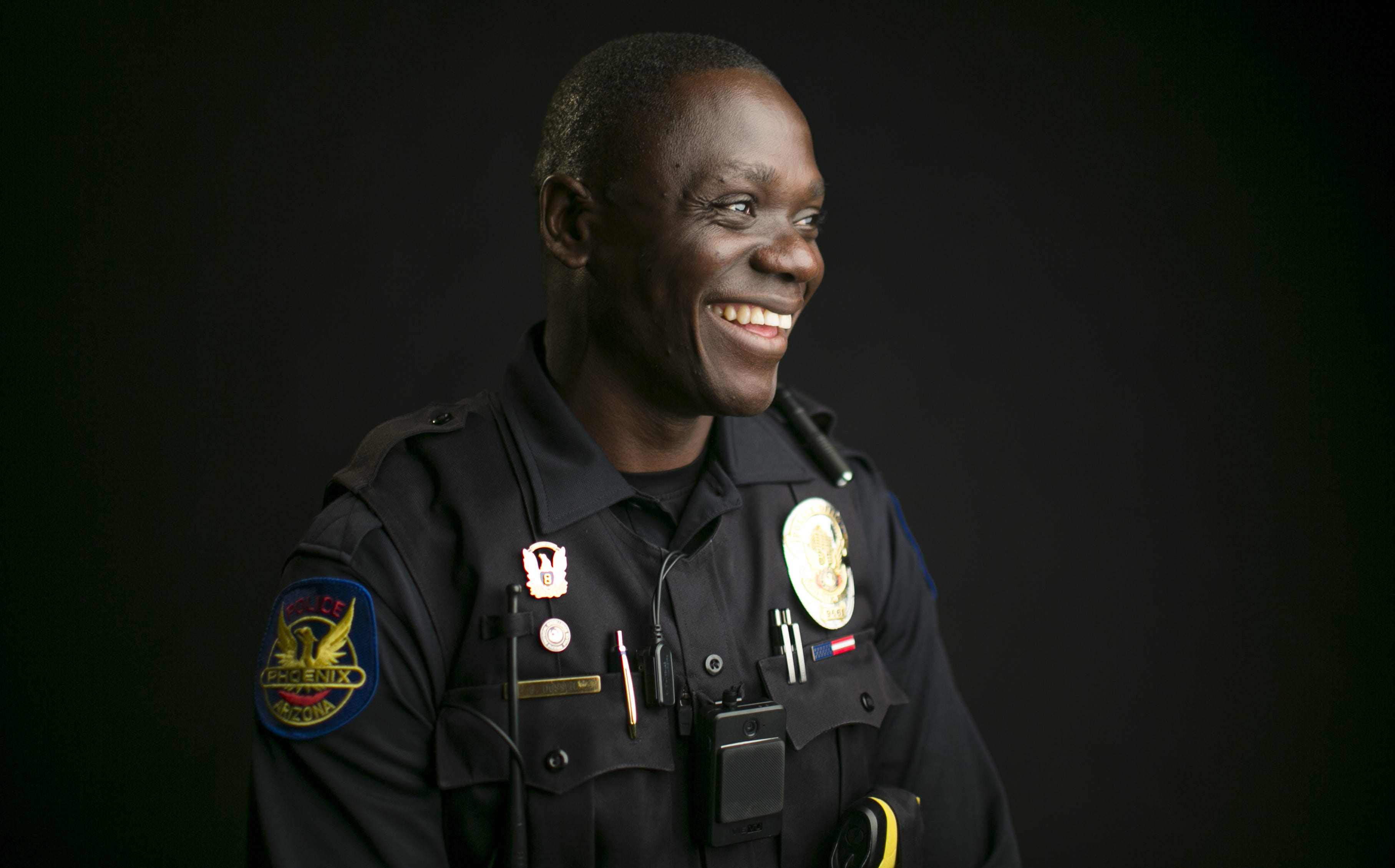 This refugee ran from guns as a kid. Now he carries one with Phoenix police