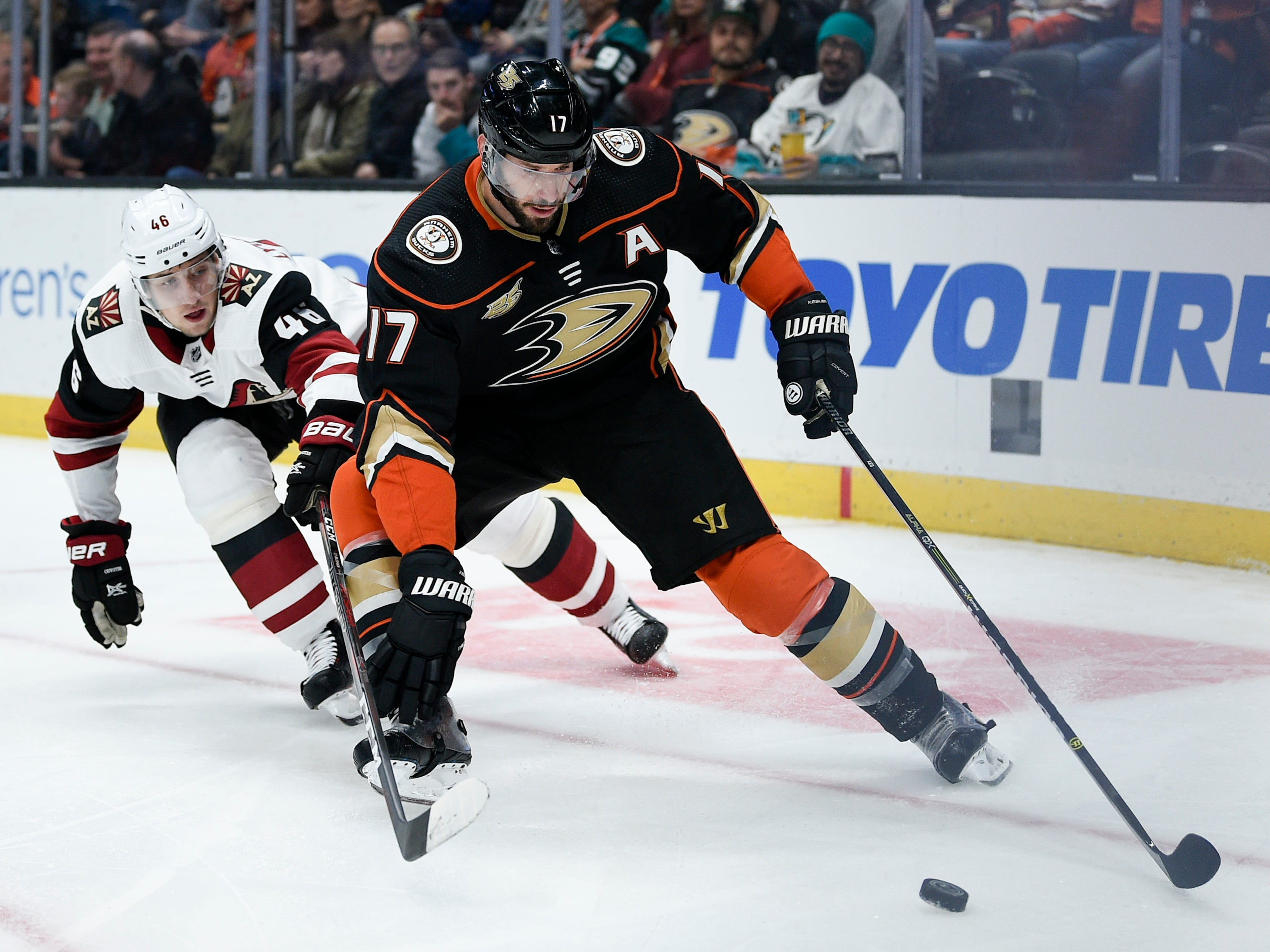 Oct 10, 2018; Anaheim, CA, USA; Anaheim Ducks center Ryan Kesler (17) handles the puck while under pressure by Arizona Coyotes defenseman Trevor Murphy (46) during the second period at Honda Center.