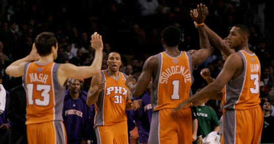 Steve Nash, Shawn Marion, Amare Stoudemire, and Boris Diaw celebrate after beating the Celtics in 2006