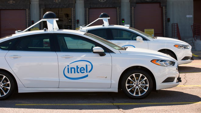 A row of Ford Fusion Hybrid data collection cars sit in the parking lot at Intel Corporation's Chandler Advanced Vehicle Lab in February 2017. Intel is the initial sponsor of an institute Gov. Doug Ducey announced Thursday, Oct. 11 to partner public and private research on self-driving cars, trucks and possibly drones. (Credit: Tim Herman/Intel Corporation)