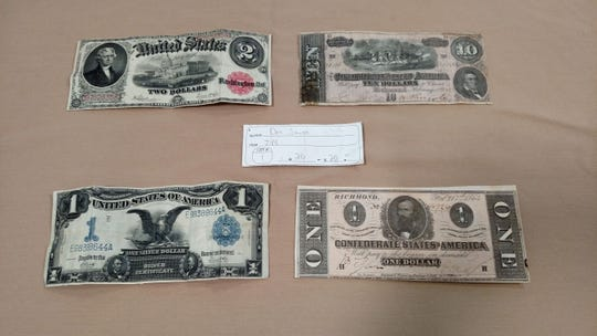 Don Smith's $20 winning auction ticket for a storage unit that contained historical documents and photos along with Civil War and other currency believed to have belonged to California Congressman Henry Ellsworth Barbour.