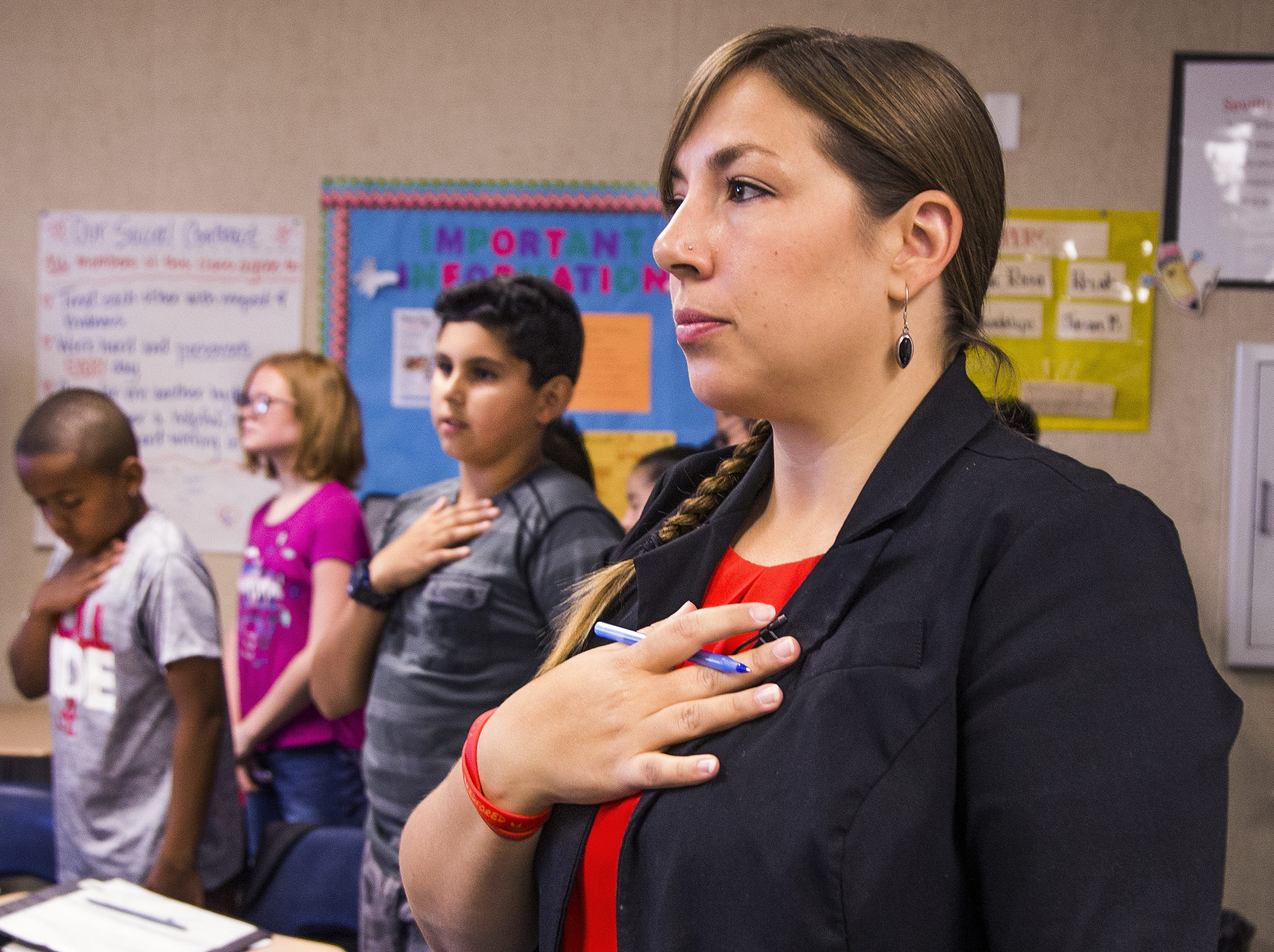 Rebecca Garelli holds her hand over her heart during the Pledge of Allegiance before her 6th grade science class at Sevilla West Elementary School in Phoenix, at 8:47 am, Monday, September 17, 2018. Garelli has been one of the leaders of the #RedforEd movement, demanding increased funding for education in Arizona.