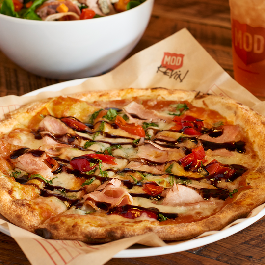 The Kevin pizza with pumpkin base at MOD Pizza.