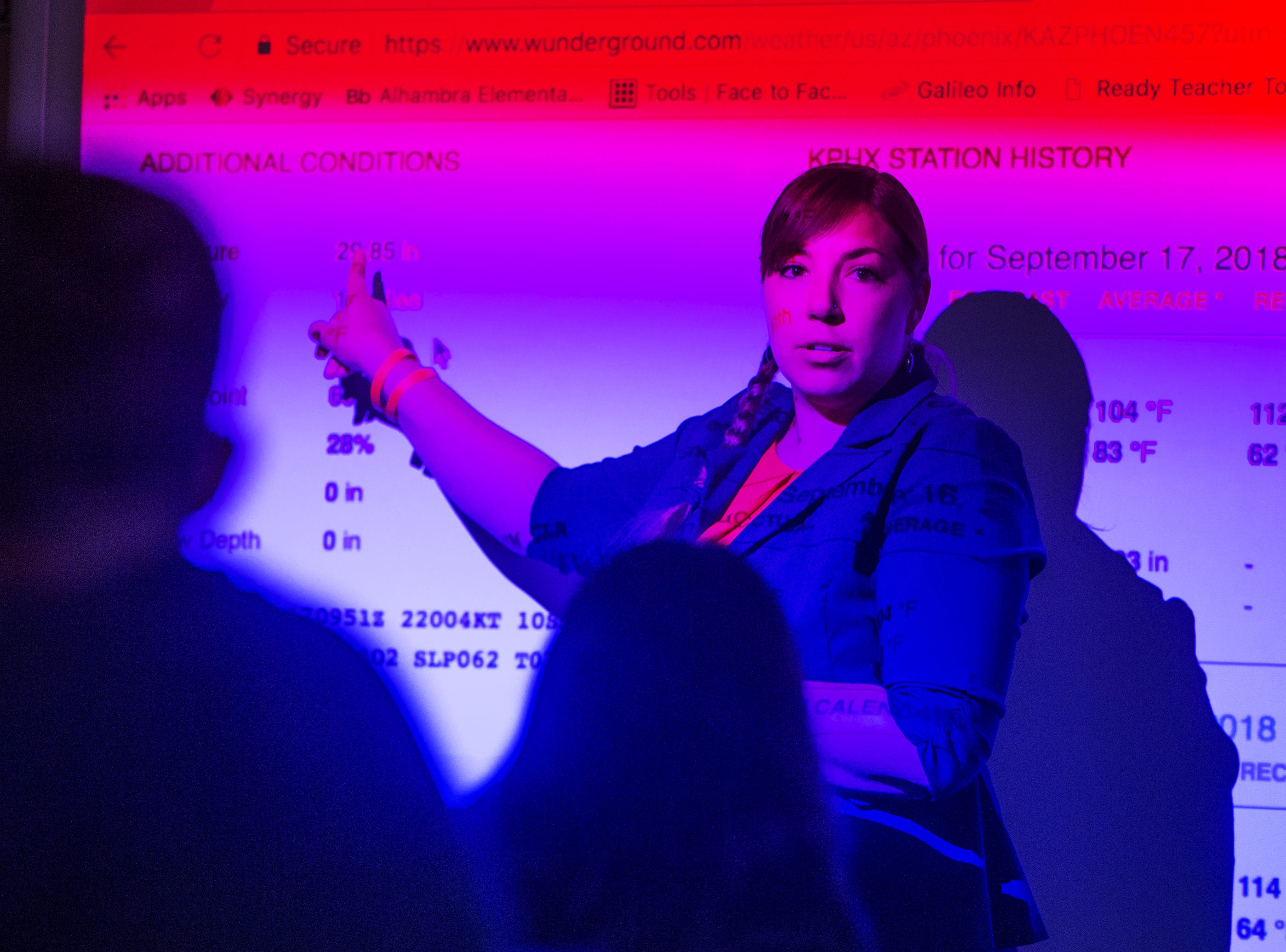 Rebecca Garelli talks about Hurricane Florence as she teaches 6th grade science at Sevilla West Elementary School in Phoenix, Monday morning, September 17, 2018. Garelli has been one of the leaders of the #RedforEd movement, demanding increased funding for education in Arizona.