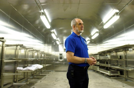 Dr. Philip Keen is shown in the cold room at the Forensic Science Center in 2003.