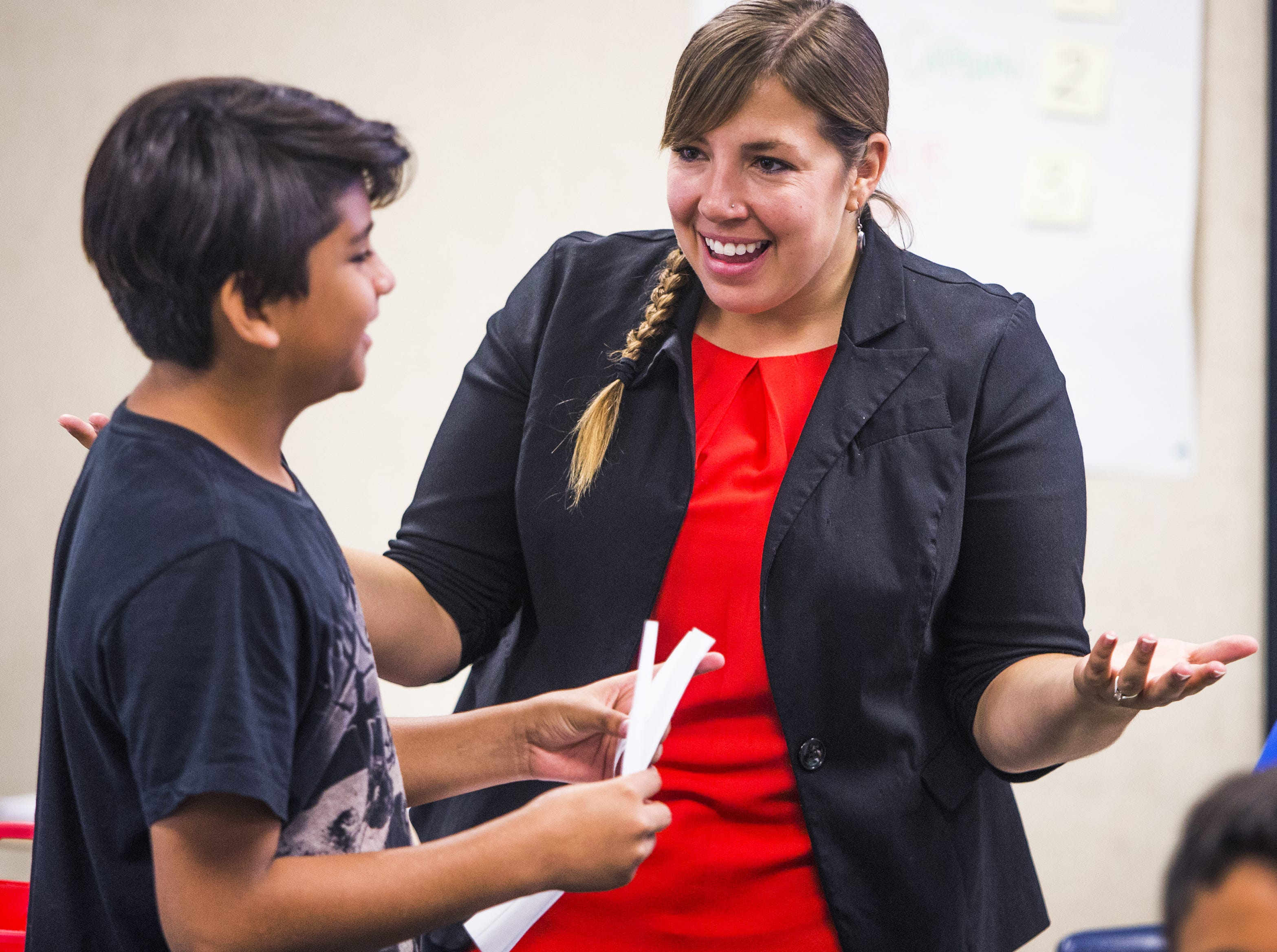 Rebecca Garelli speaks with Giovanni Romero Rodriguez, 11, during 6th grade science class at Sevilla West Elementary School in Phoenix, Arizona, Monday morning, September 17, 2018.  Garelli has been one of the leaders of the #RedforEd movement, demanding increased funding for education in Arizona.