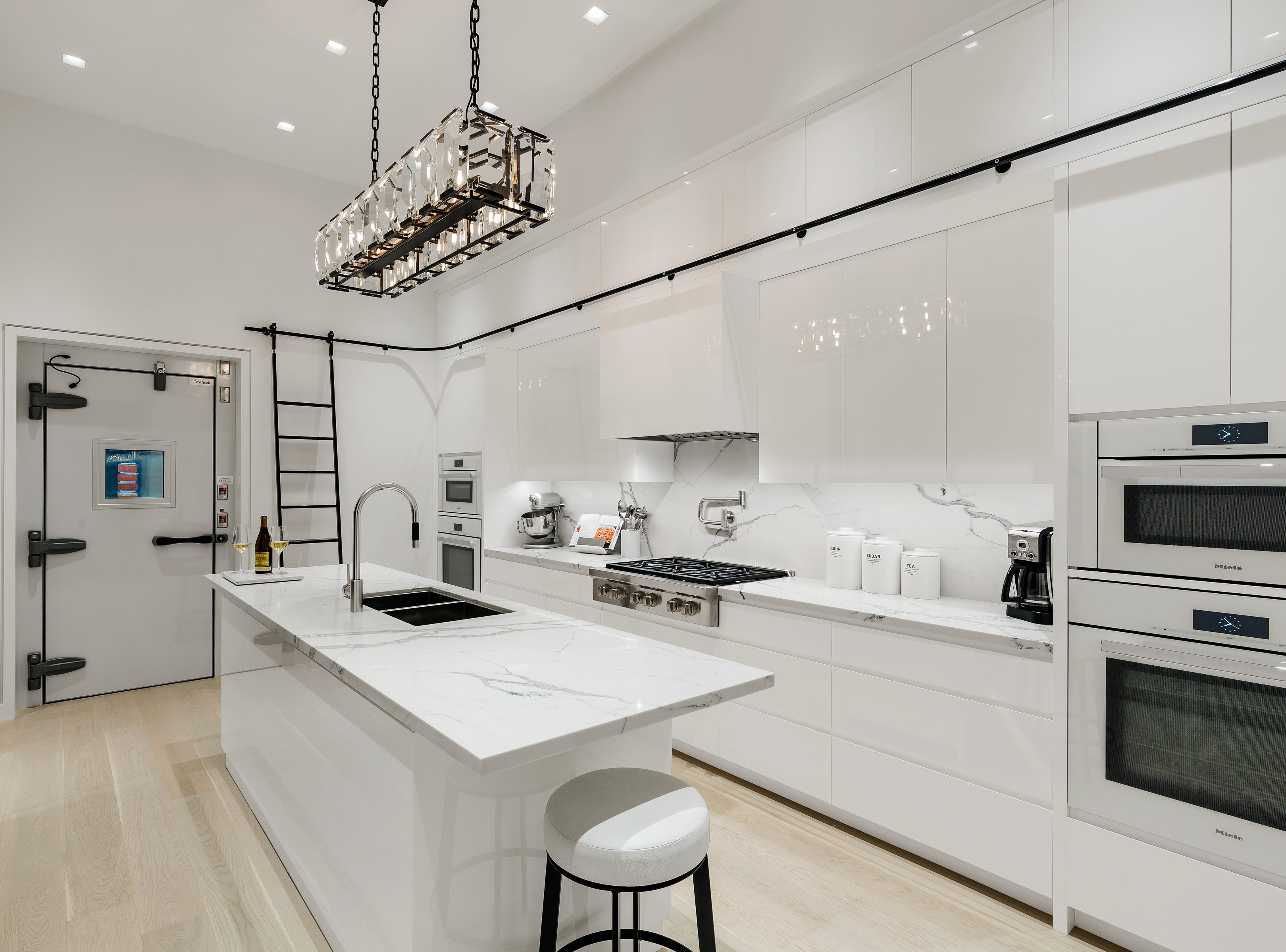 The home also features 10-foot-tall automated doors leading to numerous marble terraces, a commercial walk-in freezer and a master bathroom done entirely in Statuario marble with grey and gold veining.