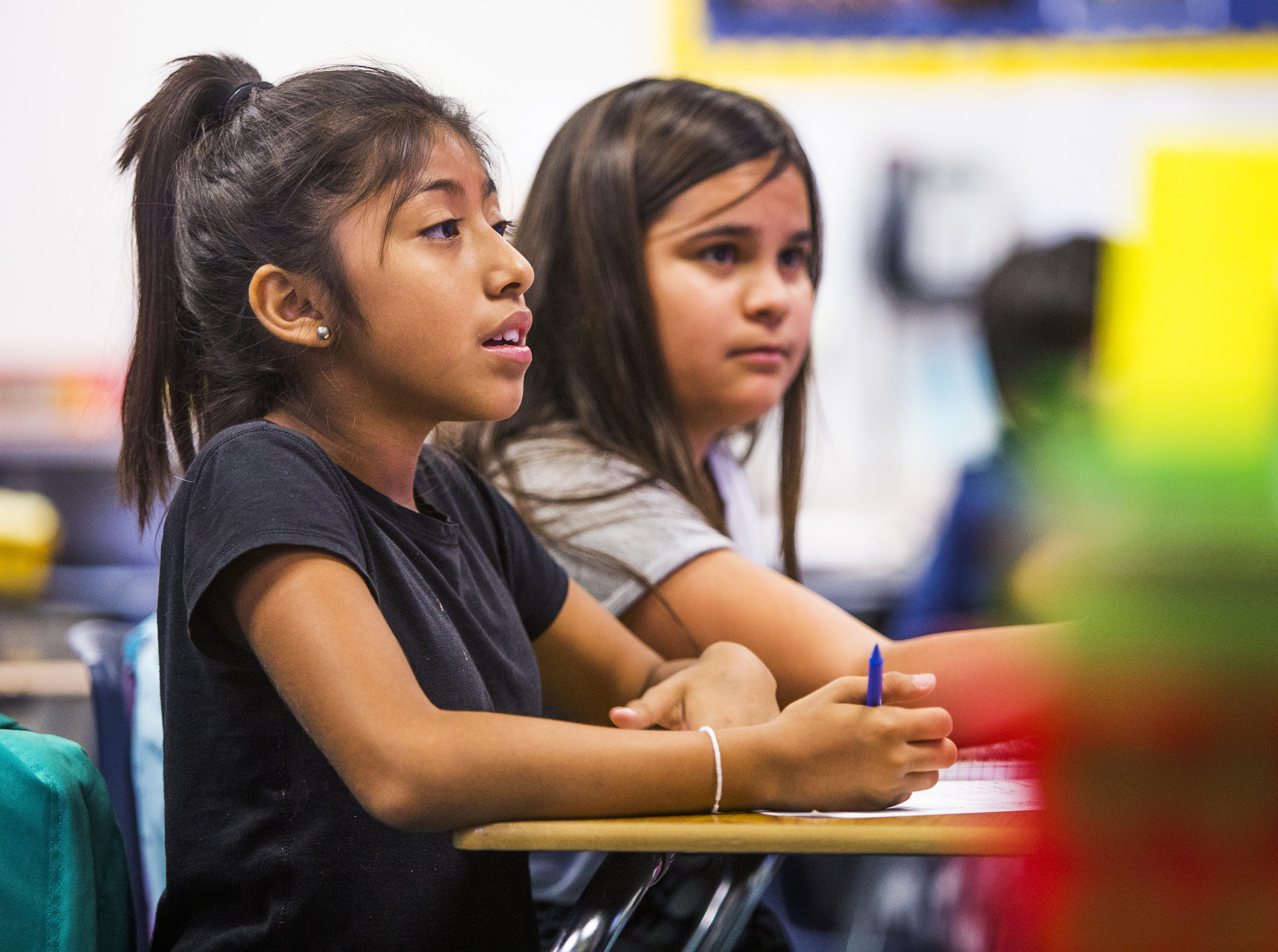Julissa Aguire Flores, 11, left, and Linda Escarrega Soberanes, 10, listen to teacher Rebecca Garelli during 6th grade science class at Sevilla West Elementary School in Phoenix, Monday morning, September 17, 2018. Garelli has been one of the leaders of the #RedforEd movement, demanding increased funding for education in Arizona.