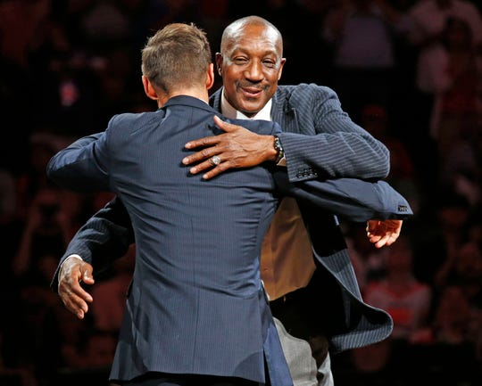 Former Walter Davis hugs Phoenix Suns NBA All-Star point guard Steve Nash during his induction ceremonies into the Suns Ring of Honor at halftime on Oct. 30, 2015 in Phoenix, Ariz.