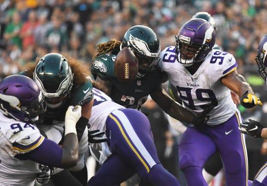 Philadelphia Eagles running back Jay Ajayi (26) fumbles the ball as Minnesota Vikings defensive end Danielle Hunter (99) defends on Oct. 7, 2018.