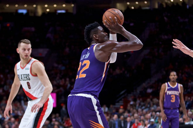 Oct 10, 2018; Portland, OR, USA; Phoenix Suns center Deandre Ayton (22) shoots against the Portland Trail Blazers during the first quarter at the Moda Center.