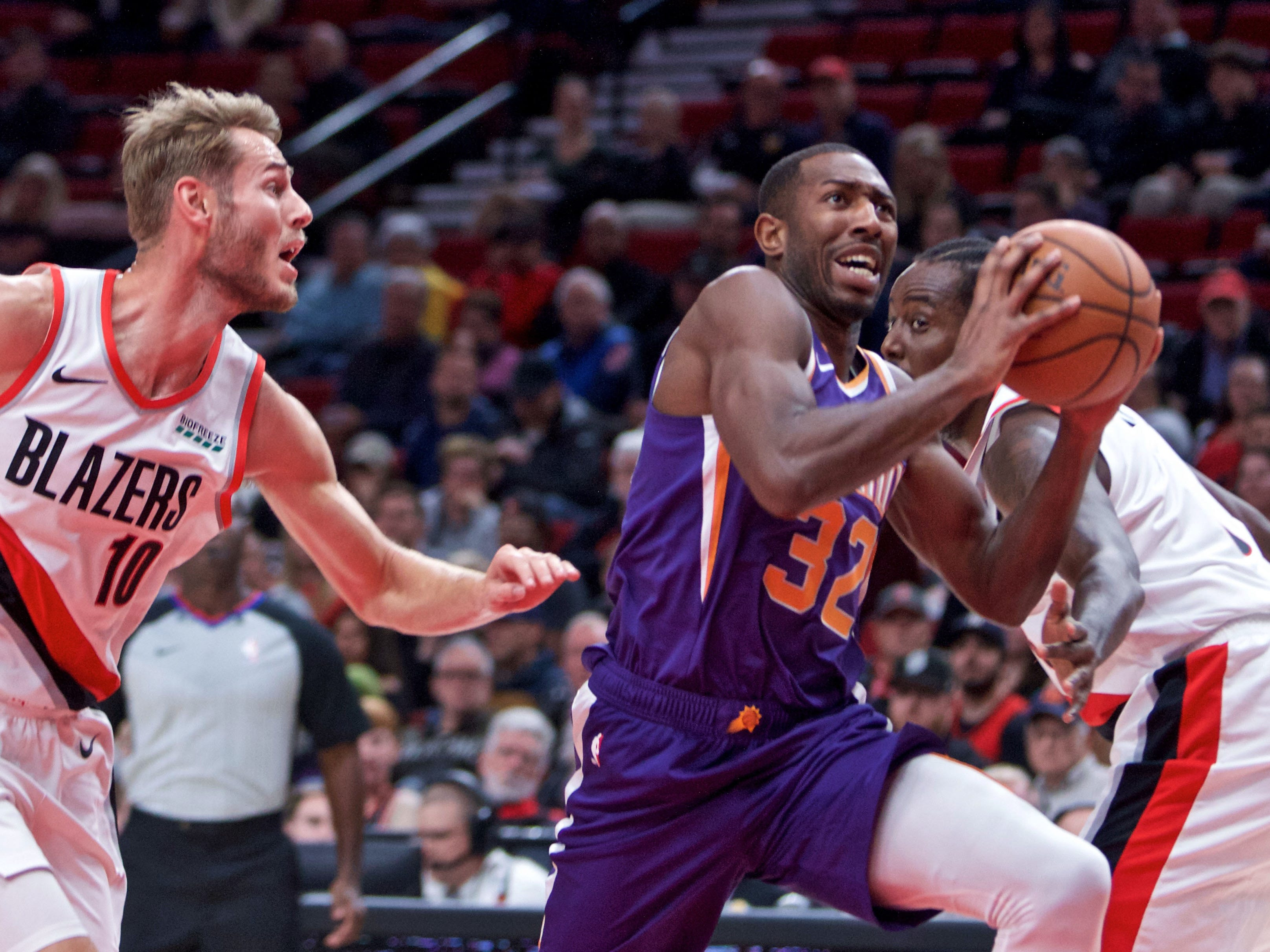 Oct 10, 2018; Portland, OR, USA; Phoenix Suns guard Davon Reed (32) drives past Portland Trail Blazers forward Jake Layman (10) during the first quarter at the Moda Center.