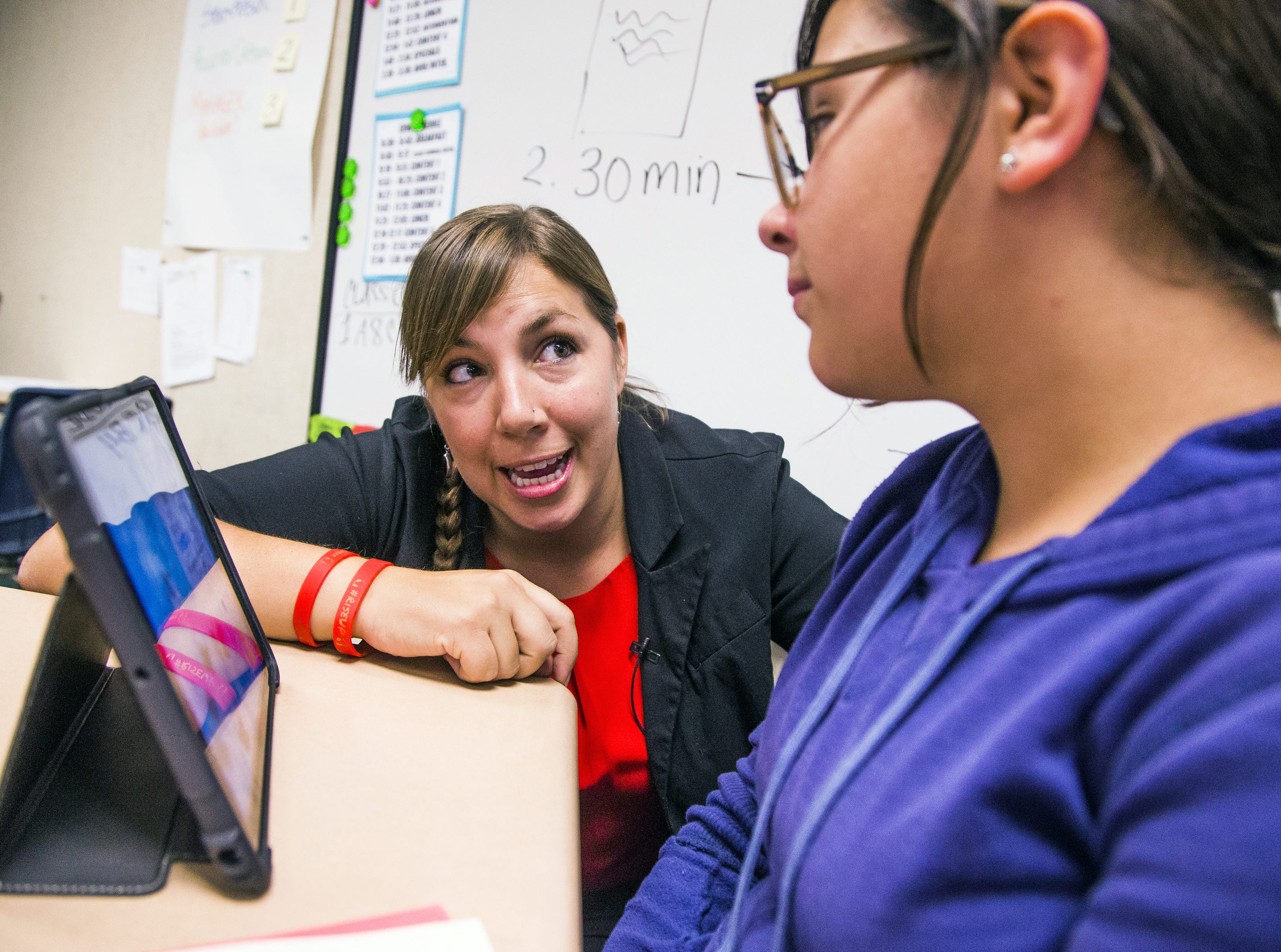 Rebecca Garelli helps Victoria Emery, 12, during her 6th grade class at Sevilla West Elementary School in Phoenix, at 3:04 pm, Monday, September 17, 2018. Garelli has been one of the leaders of the #RedforEd movement, demanding increased funding for education in Arizona.