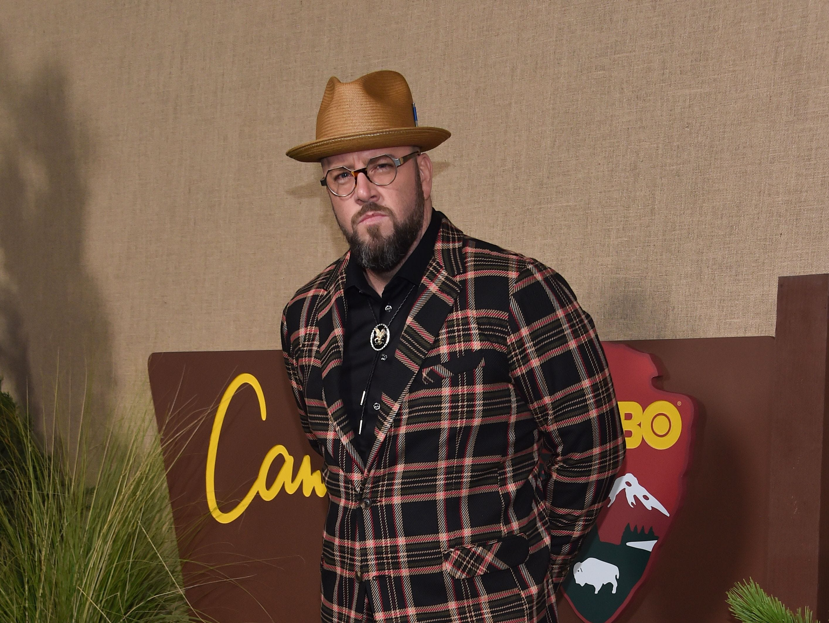 """This Is Us"" star Chris Sullivan arrives for the HBO series premiere of ""Camping"" on Oc. 10, 2018, in Los Angeles."