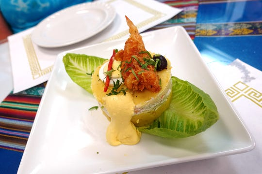 Causa relleno camarones with mashed potatoes and Peruvian shrimp salad at Los Andes Peruvian Cuisine in Phoenix.