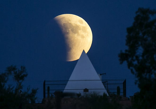 The moon rises over Hunt's Tomb in Papago Park on Sept. 27, 2015.