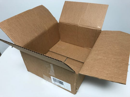 Cardboard boxes can go with curbside recycling bins, but they should be broken down and flattened before being placed on or in the bin.