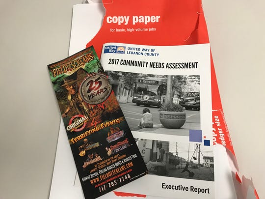 Examples of paper products that cannot go into curbside recycle bins. Magazines and copy paper can be taken to designated recycling centers but cannot be placed in curbside recycle bins.