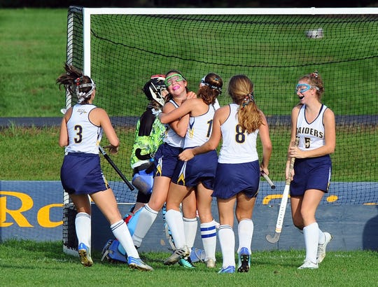 Elco's Anya Kissinger (13) gets a hug from her teammate Abbie Keath (11) after she scored the only goal of the game late in the first half.