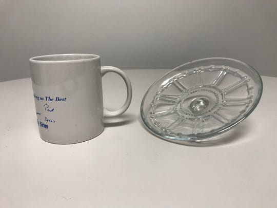 Examples of glass products that cannot go into curbside recycling bins. Items such as windowpane glass, drinking glasses and ceramic items are not allowed in the recycle bin.