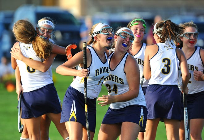 Elco's Abbie Keath(11) and Julia Angstadt(34) have big smiles with their teammates after the big win over Annville Cleona in a game played Wednesday Oct.10,2018 at Elco.
