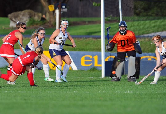 Elco's goalie Sarah Shollenberger(01) stops a shot from Annville-Cleona's Erin Schrader(1) late in the second half of Elco's 1-0 win on Wednesday in Myerstown.