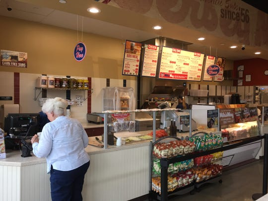 A customer stands in line at Jersey Mike's Subs, a sandwich chain that recently opened at Hershey Towne Square.