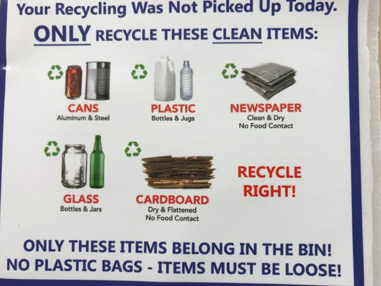 A recycling bin tag that will be placed by waste haulers on contaminated bins found at pickup.