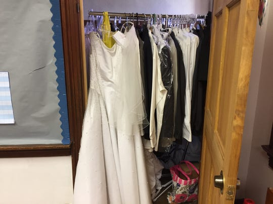 A closet at Calvary Chapel is bursting with wedding dresses and men's suits, all donated for One Big Wedding on Saturday, Oct. 13.