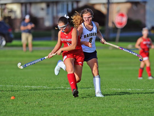 Annville-Cleona's Elizabeth Matusiak (6) and Elco's Amanda Smith (8) chase the ball during first half action in a game played Wednesday Oct.10,2018 at Elco.