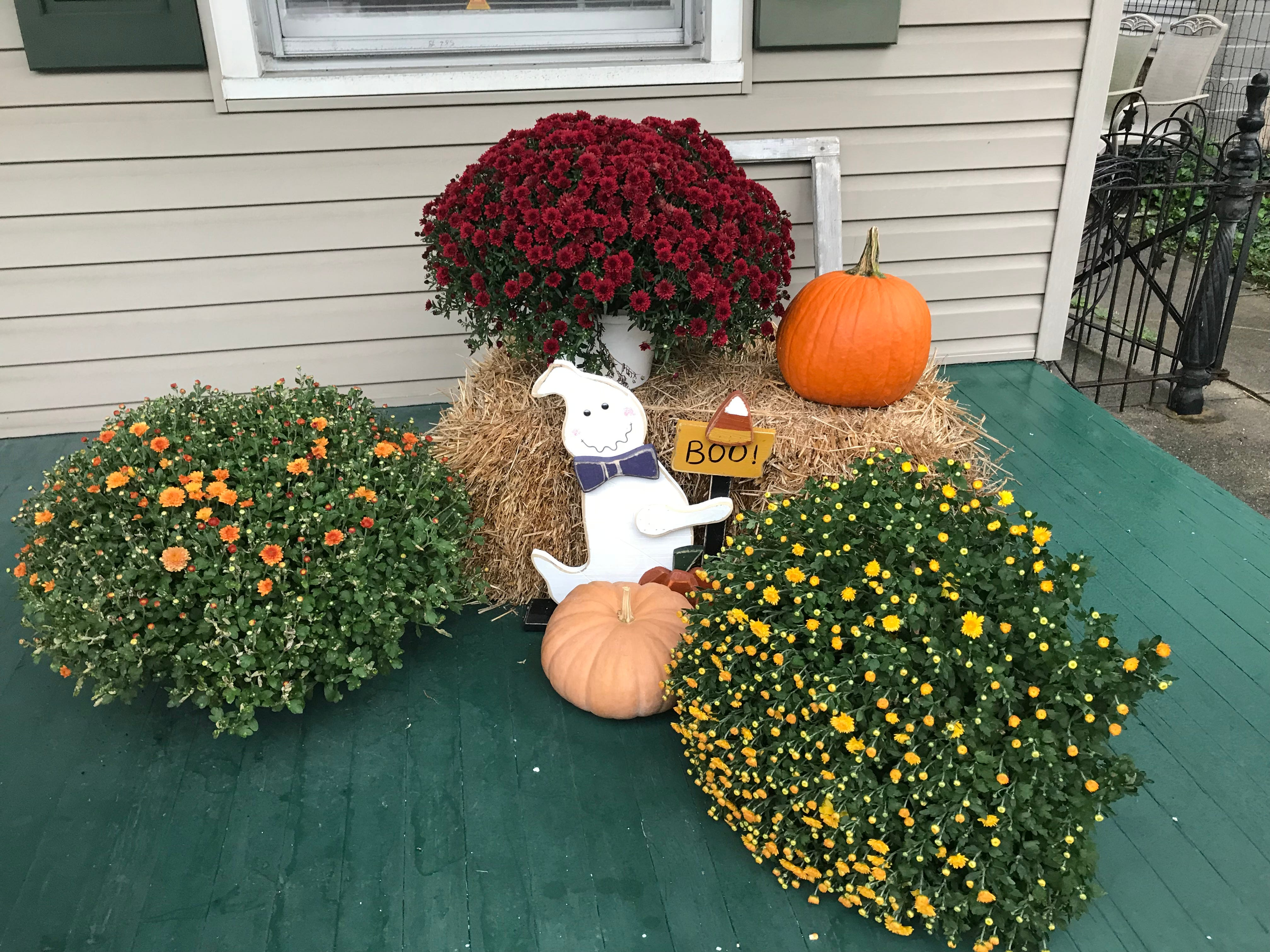 A Halloween ghost hiding among fall decorations on Fulton Street in Ephrata Borough, Lancaster County.